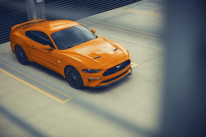2020 Ford Mustang G T in Twister Orange Metallic tinted clearcoat in a parking lot