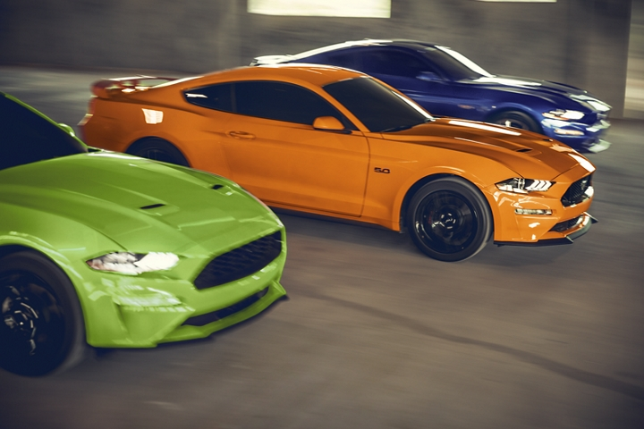 Three 2020 Ford Mustang models in a parking garage