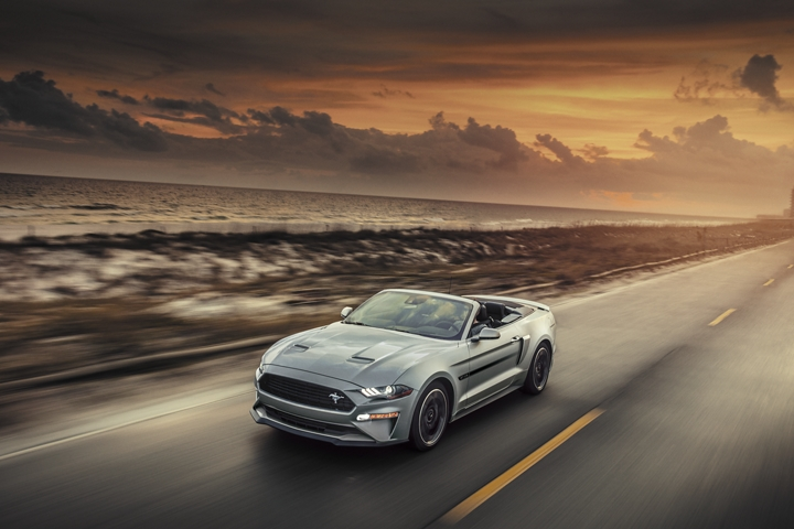 2020 Ford Mustang travelling down a highway in the desert