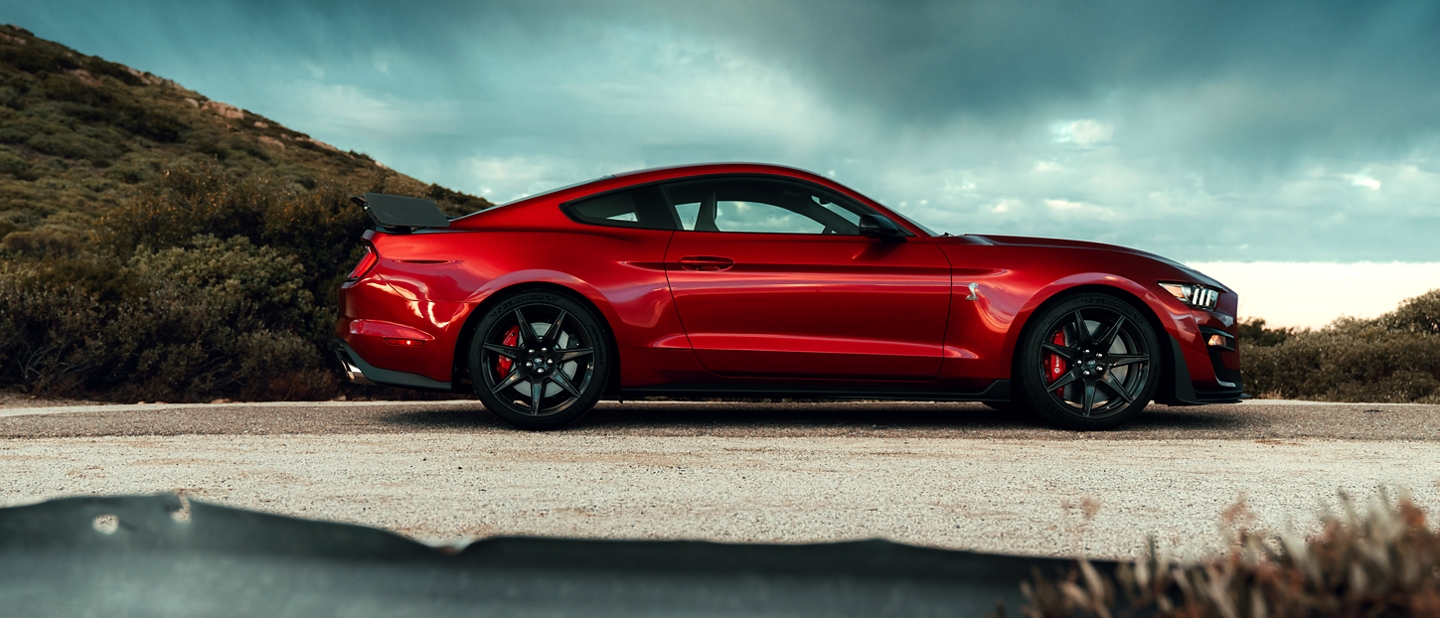 2020 Ford Mustang Shelby G T 500 in Rapid Red with a mountain in the background