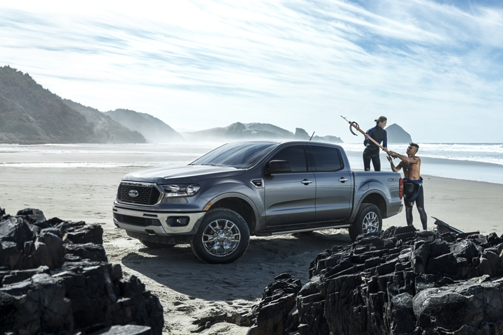 2019 Ford Ranger at parked by a large body of water with two people unloading scuba gear