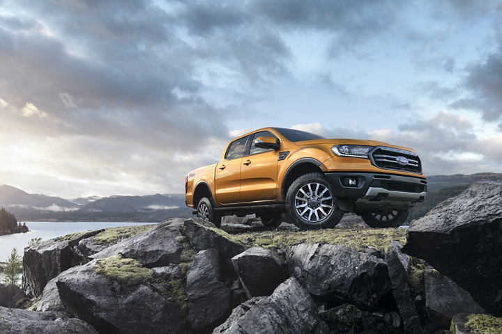 2019 Ford Ranger on rocky terrain with a lake in the background