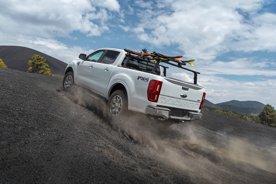 2019 Ford Ranger powering up hill on desert terrain