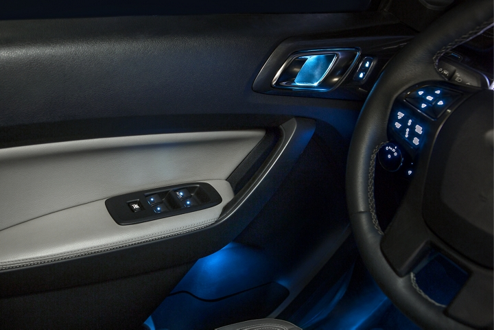 LARIAT interior showing Blue Ambient Lighting in the driver side foot well
