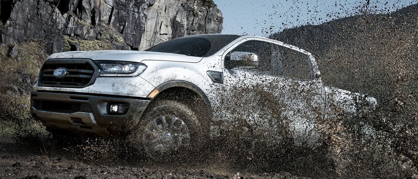 2020 Ford Ranger in Iconic Silver driving through muddy terrain