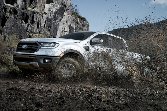 2020 Ford Ranger in Iconic Silver being driven in the mountains on dirt terrain