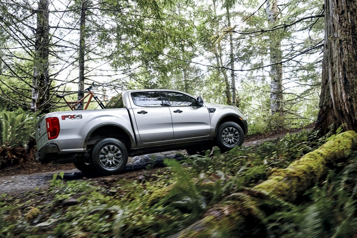 2020 Ford Ranger travelling uphill on forest road with optional bed mounted rack accessory