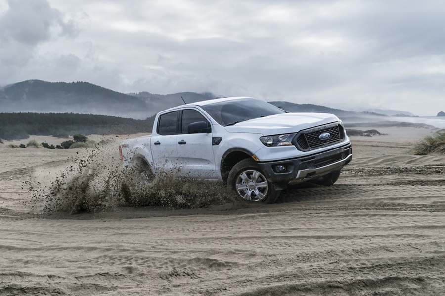 2020 Ford Ranger in Iconic Silver cornering hard across sand dune
