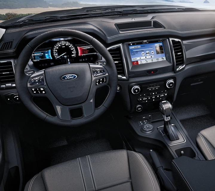 2020 Ford Ranger interior in Ebony with available technology including eight inch centre dash screen display