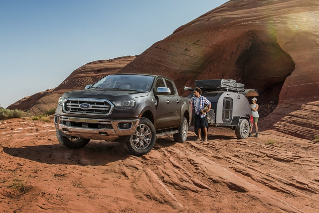 2020 Ford Ranger in Magnetic with camper trailer on hilly desert terrain