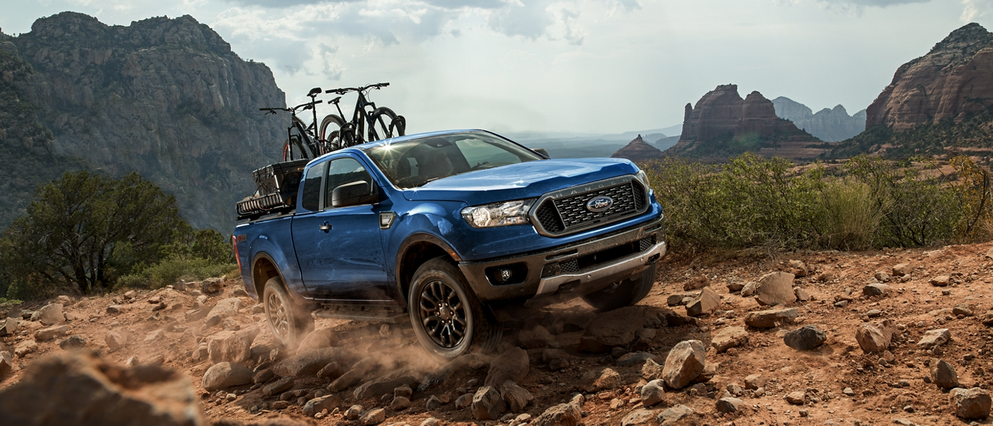 2020 Ford Ranger in Lightning Blue being driven off road on rocky path