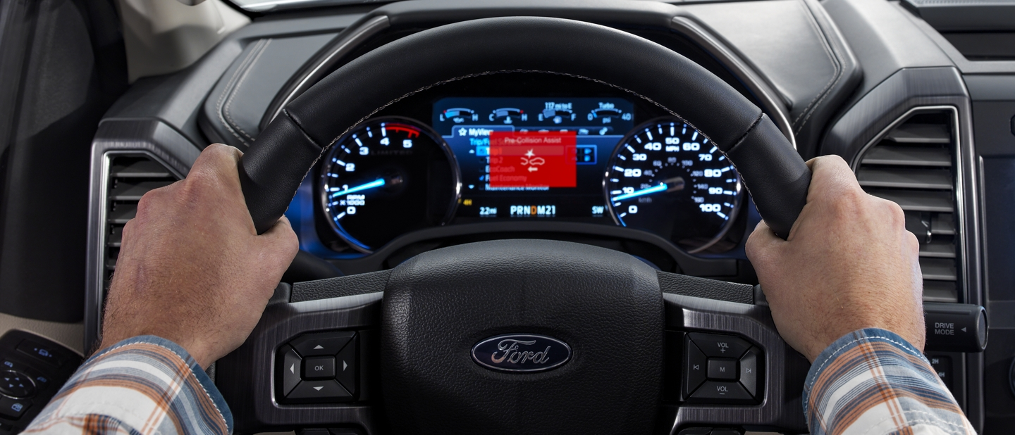 Close up view of drivers side dashboard displaying pre collision warning