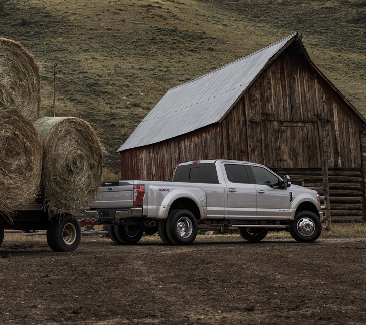 A 2020 Super Duty tows heavy bales of hay on a ranch