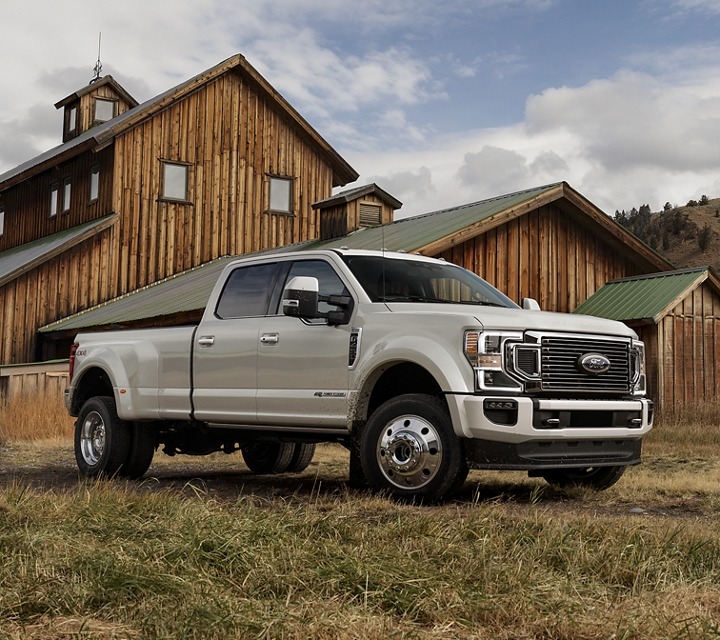 2020 Ford Super Duty F 4 50 on a farm with farmer and horse in the background