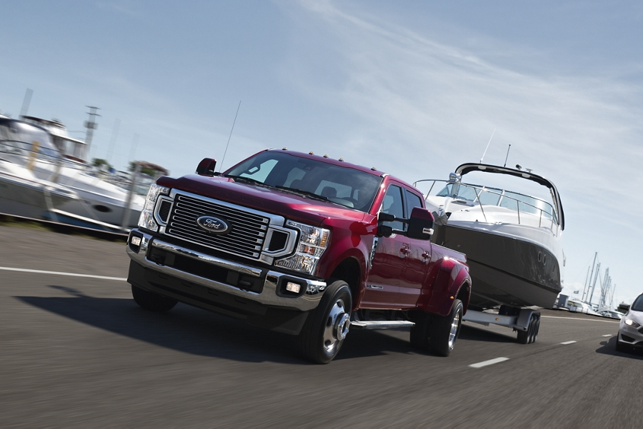2020 Ford Super Duty shown towing a boat on the highway