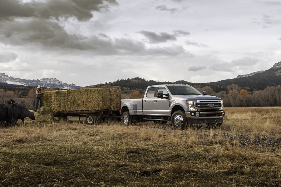 2020 Ford Super Duty with fifth wheel hitch towing a horse trailer