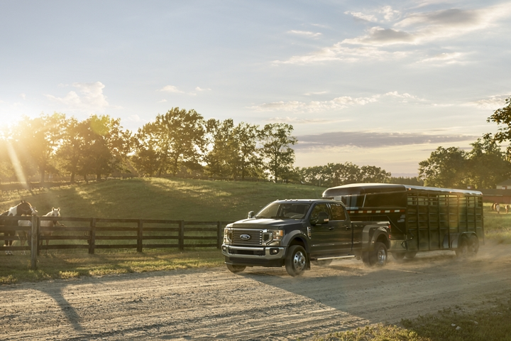 2020 Ford Super Duty F 4 50 towing a trailer down a country road
