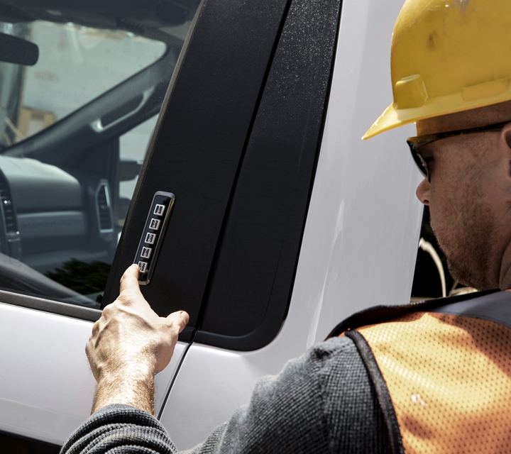 Man pushing buttons on 2020 Ford Super Duty Securicode keyless entry keypad