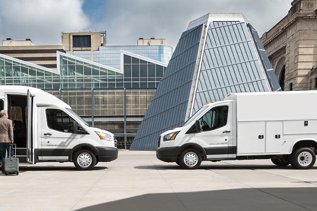 2020 Ford Transit with aftermarket shuttle bus body on left and Transit with aftermarket utility body on right