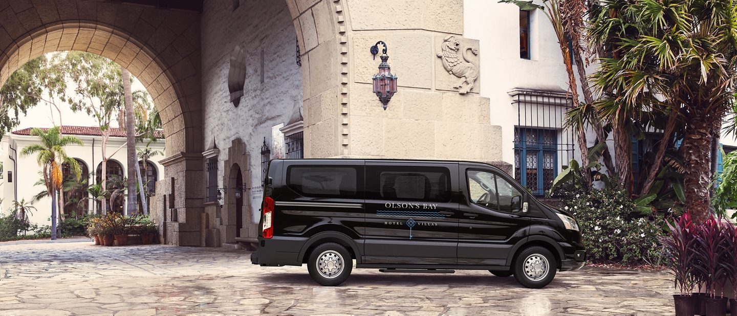 2020 Ford Transit in front of hotel entrance