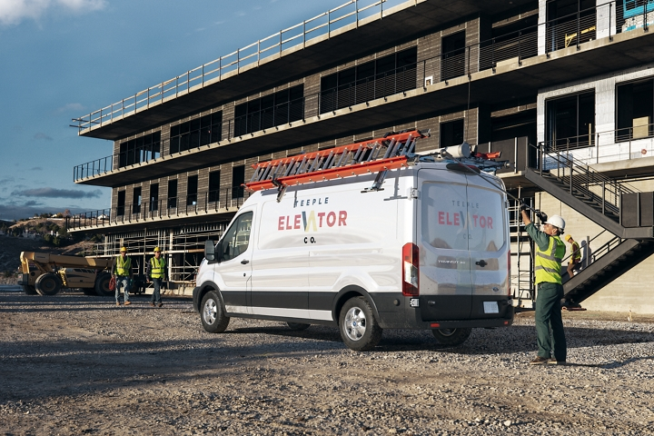 Rear three quarter view of the 2020 Ford Transit Cargo Van at a construction site