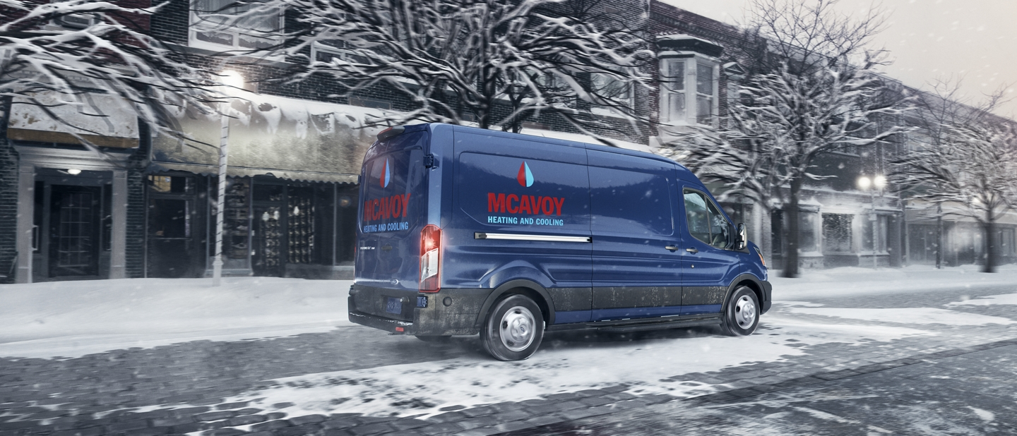 A 2020 Ford Transit being driven in the snow