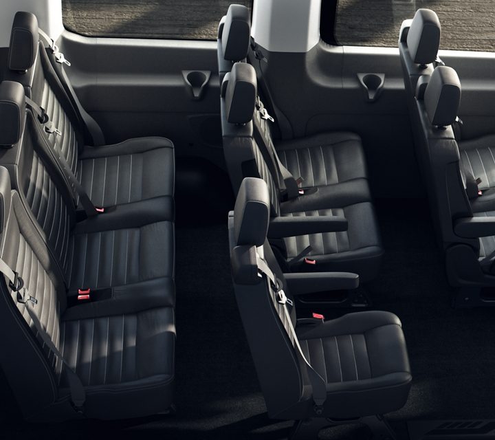 The interior seating of the transit passenger van