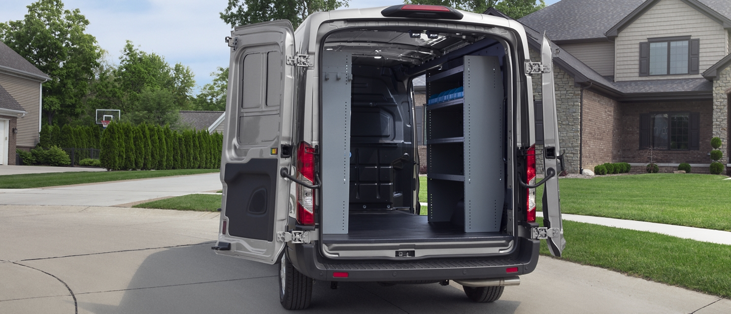 A 2020 Ford Transit from behind with open cargo doors