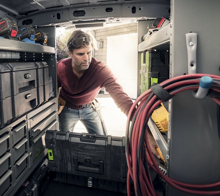 2020 Ford Transit Connect Cargo area showing man at work with aftermarket upfitted shelving