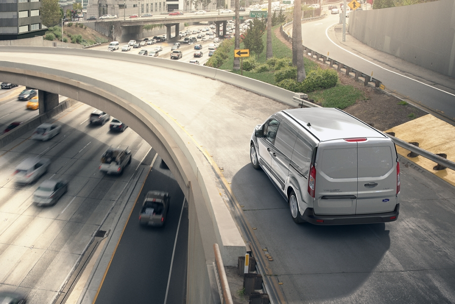 A 2020 Ford transit connect being driven over a bridge