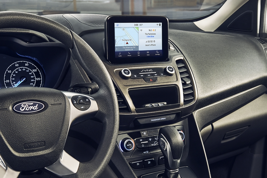 Interior shot depicting driver wirelessly charging their smartphone