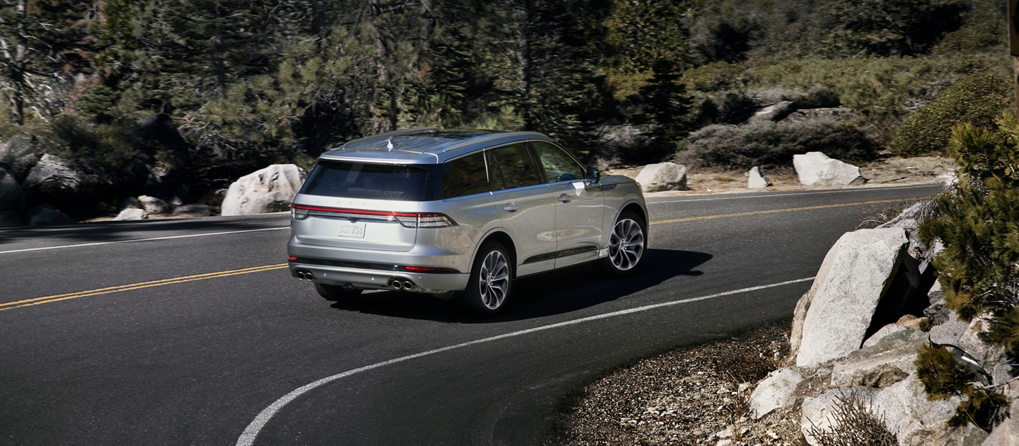 Lincoln Aviator shown heading into a turn on a mountain road
