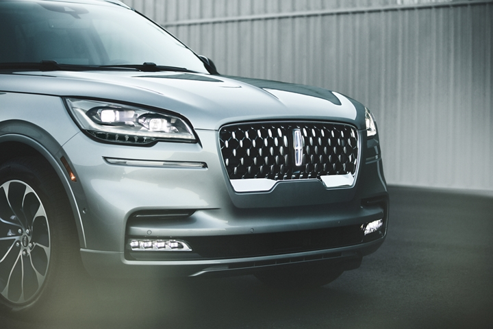 The bold front grille and headlamps show off the available Illumination Package