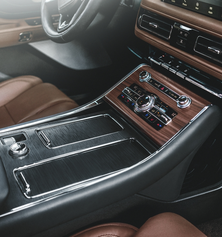 The front centre console is shown with chrome like detail and engine turned aluminum applique