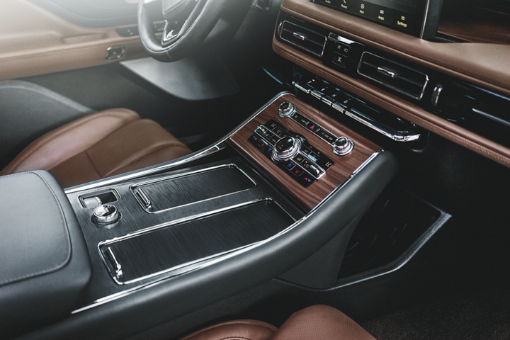 The front centre console is shown to highlight aviation inspired materials used throughout the cabin