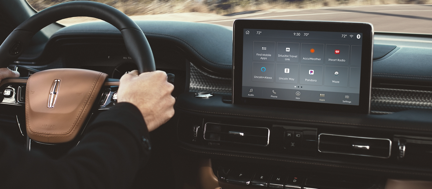 Tidal a streaming music and entertainment service is shown in the centre screen of a Lincoln Aviator