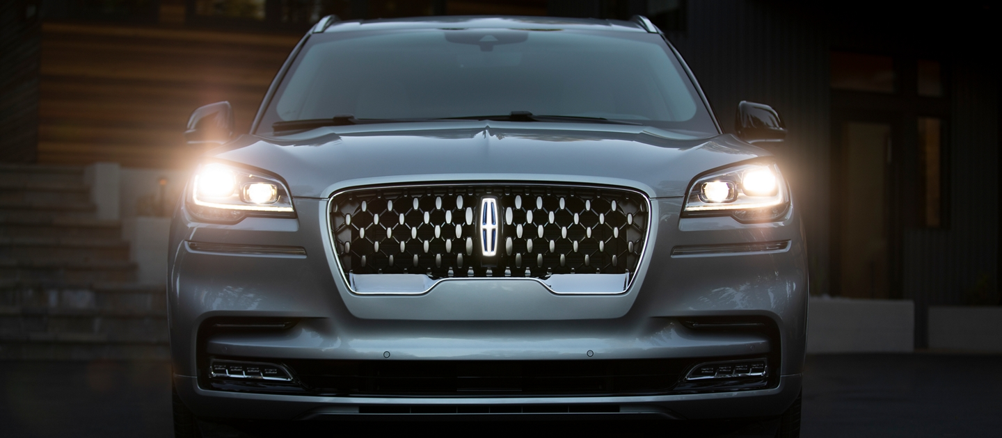 The adaptive pixel L E D headlamps of the Lincoln Aviator are shown in their illuminated state
