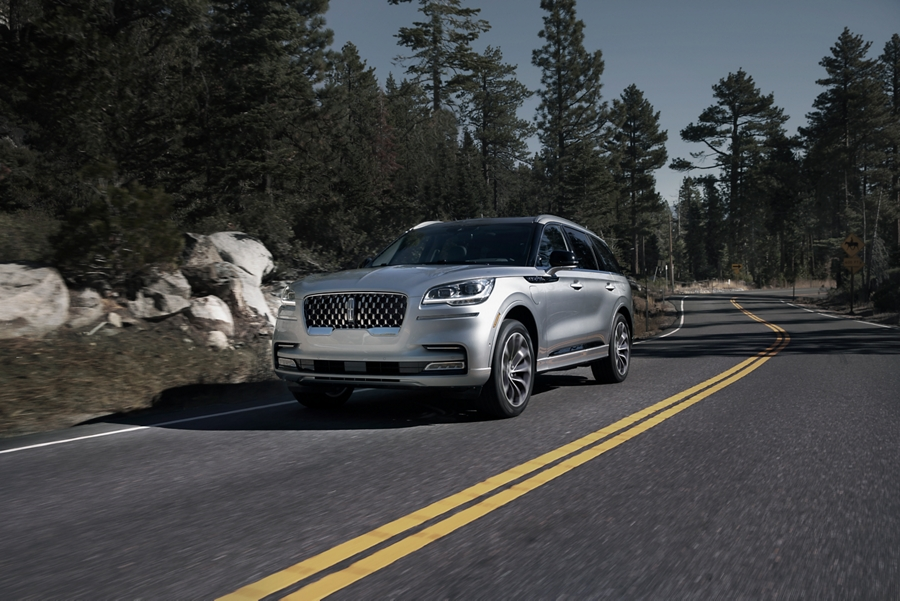 A Lincoln Aviator is shown driving down a winding mountain road