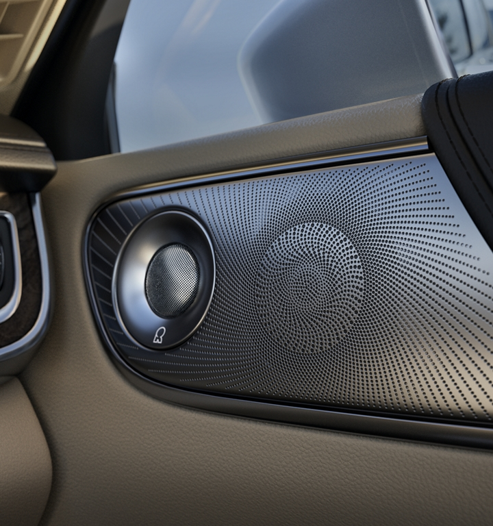 A close up image shows the speaker cover of the sound system in the front passenger door in a 2020 Lincoln Continental