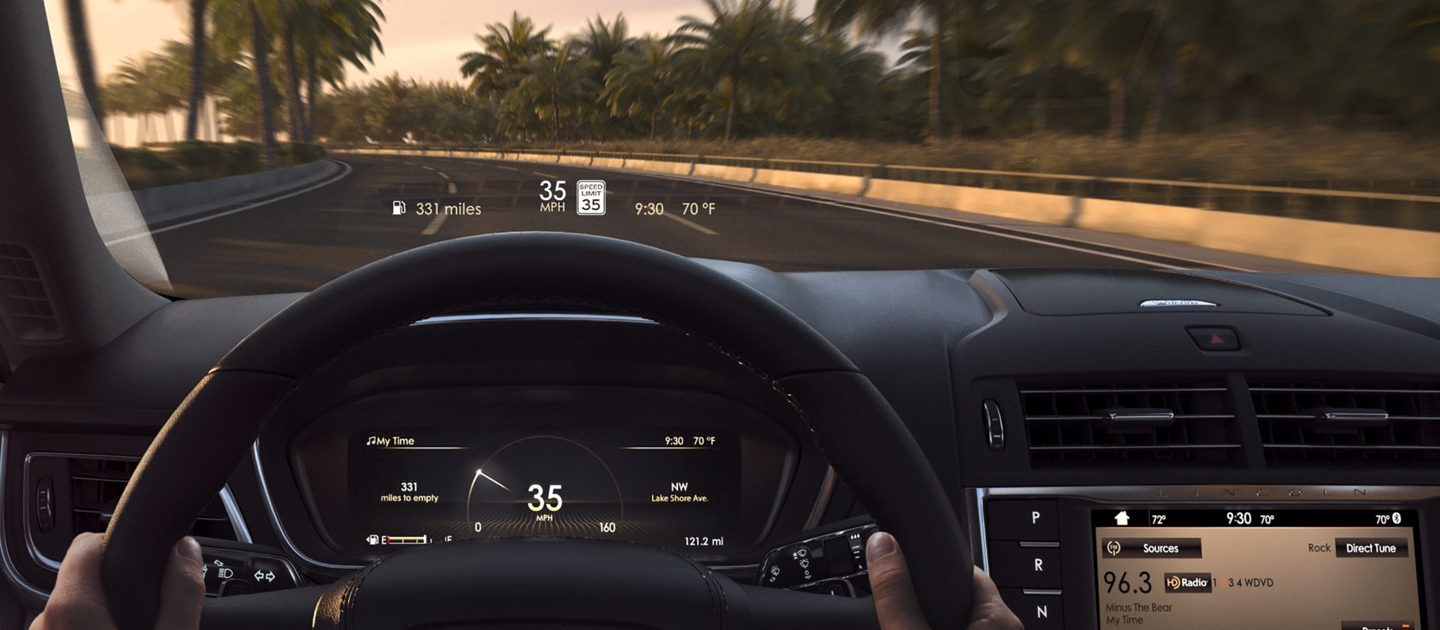 The Head Up Display is shown projected on the inside of the windshield of a 2020 Lincoln Continental as it is being driven on a coastal road
