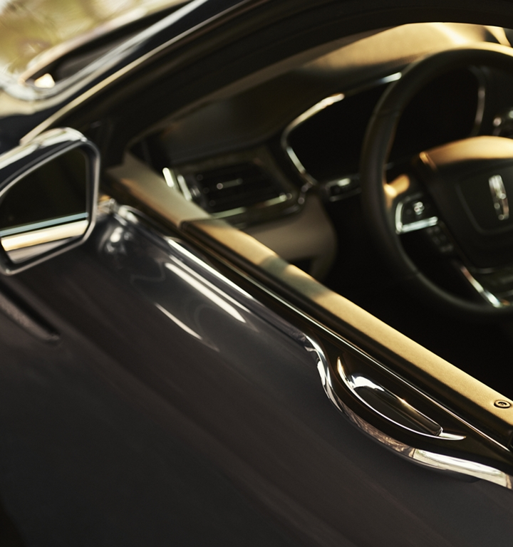 The sleek beltline of a 2020 Lincoln Continental is shown with the light touch door handle seamlessly positioned in the drivers door