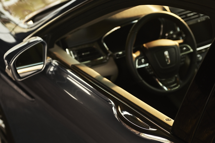The Light Touch door handle is shown integrated into the beltline giving the Continental uninterrupted design lines