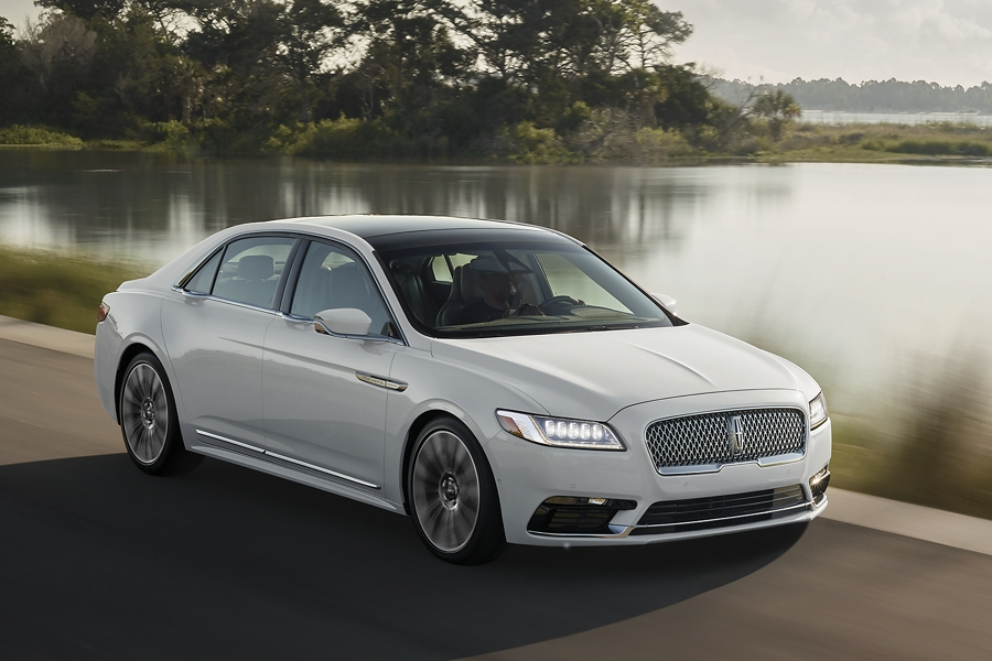 A 2020 Lincoln Continental is shown being driven at a pace that would best be served by using the adaptive suspensions sport setting