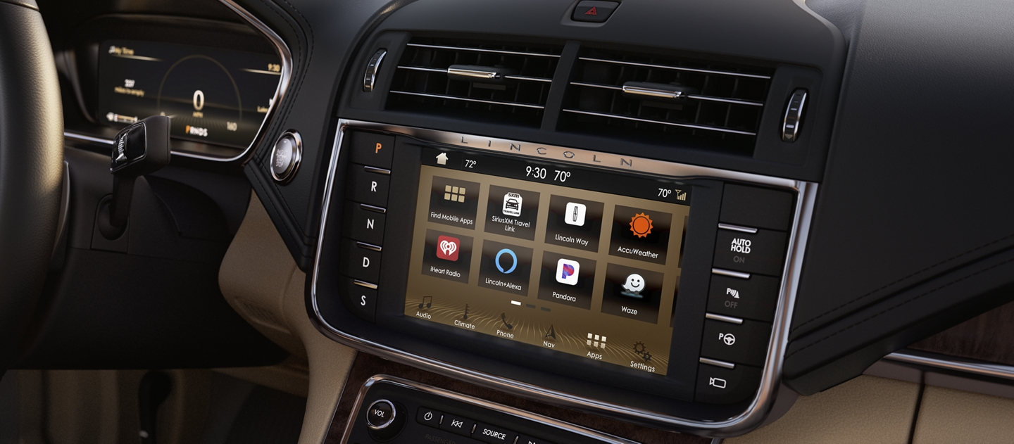 The centre touchscreen of a 2020 Lincoln Continental displays various apps via the sync 3 app link