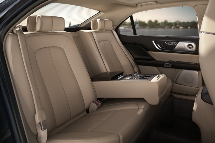 A rear seat view of the 2020 Lincoln Continental shows the available Rear Seat Amenities Package