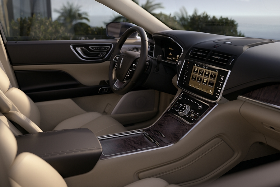 The dash board and centre console are shown to highlight how the interior offers a virtually seamless experience