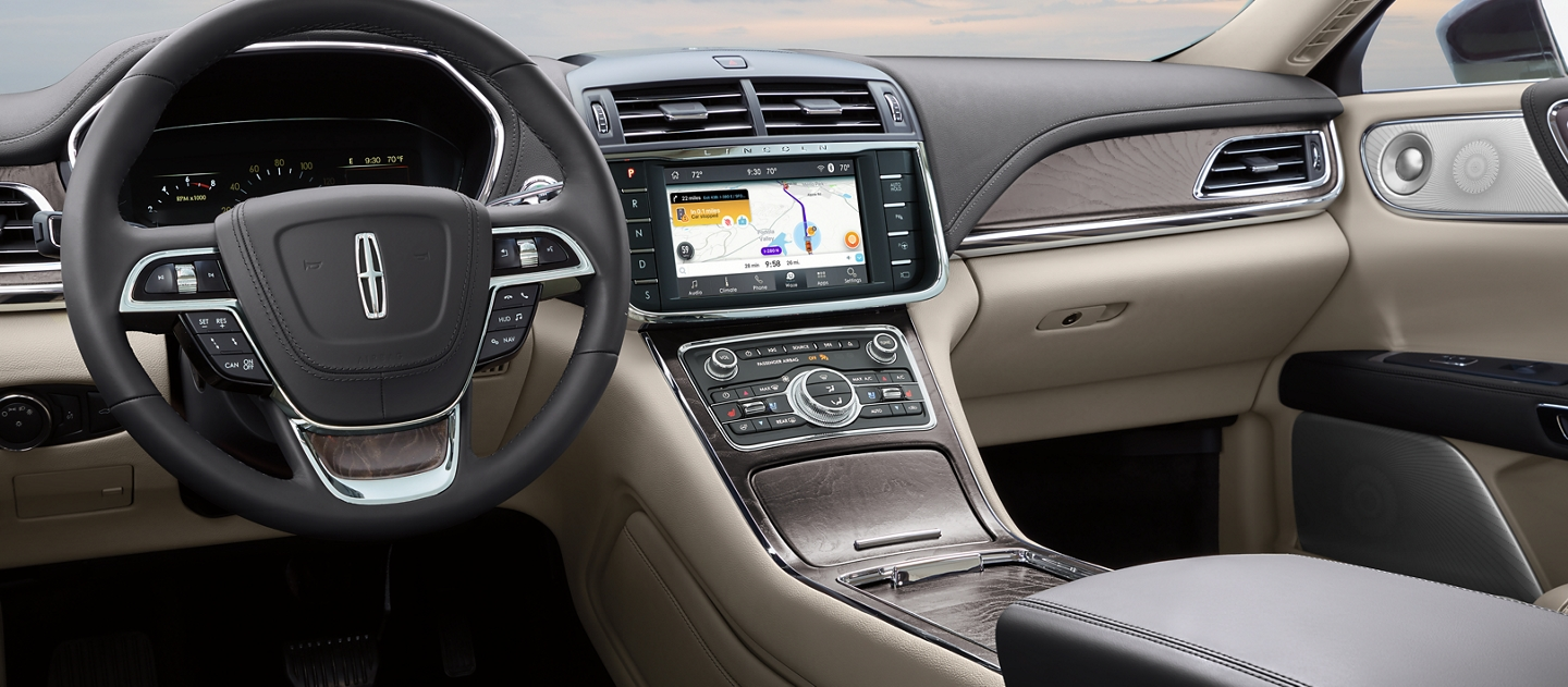The Waze Interface is shown in the centre touch screen of a 2020 Lincoln Continental to help you navigate your way around traffic jams