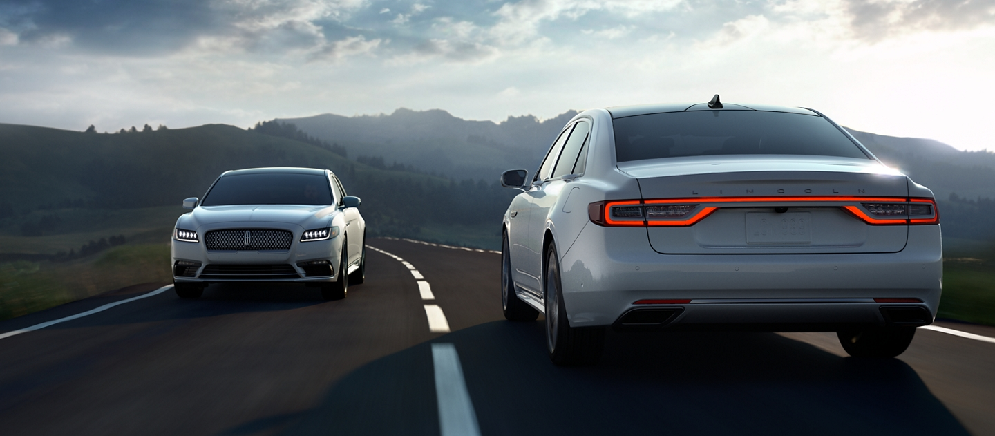 A 2020 Lincoln Continental is being driven past another vehicle demonstrate the Lane Keeping System