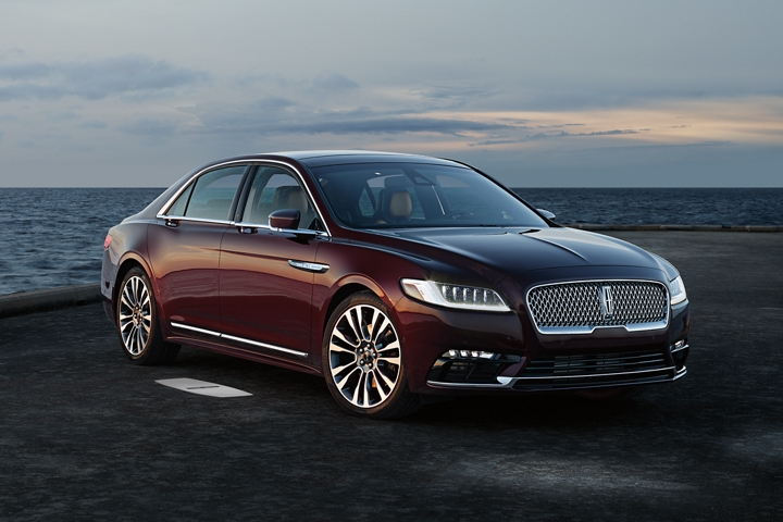 A 2020 Lincoln Continental shown in the Burgundy Velvet Metallic Tinted Clearcoat exterior colour is parked near the ocean