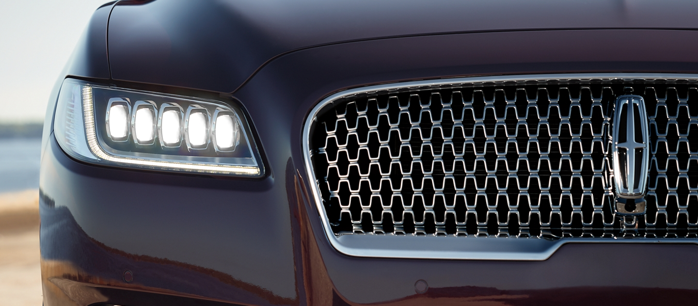 A close up image shows the illuminated headlamps of a 2020 Lincoln Continental